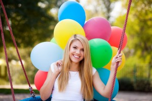 Young beautiful woman with colorful balloons